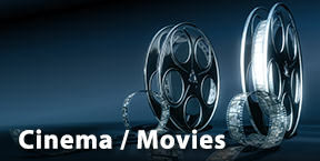 Two movie reels spewing film