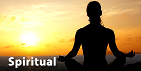 A spiritually healthy individual partaking in yoga during a sunrise.